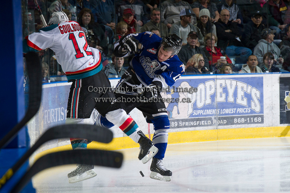 KELOWNA, CANADA - JANUARY 2:  Tyrell Goulbourne #12 of the Kelowna Rockets checks Tim Traber #12 of the Victoria Royals at the Kelowna Rockets on January 2, 2013 at Prospera Place in Kelowna, British Columbia, Canada (Photo by Marissa Baecker/Shoot the Breeze) *** Local Caption ***