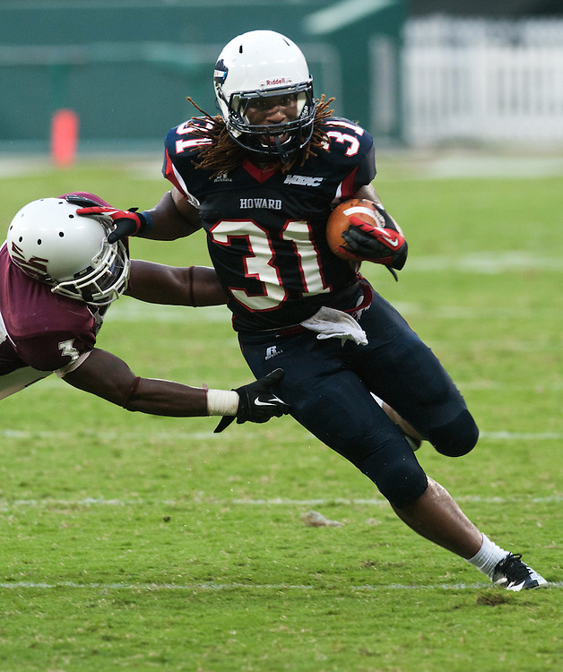 Washington DC--Howard University halfback Justin Duncan pushes aside Morehouse College cornerback DeAngelo Julks during the final, come from behind drive near the end of the 4th quarter of the AT&T Nation's Football Classic Saturday afternoon at RFK Stadium in Washington, DC . Howard University defeated Morehouse College 30-29.  (Photo by Alan Lessig)