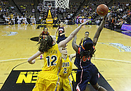February 24 2011: Illinois Fighting Illini forward Karisma Penn (00) puts up a shot over Iowa Hawkeyes center Morgan Johnson (12) and Iowa Hawkeyes guard Kamille Wahlin (2) during the first half of an NCAA women's college basketball game at Carver-Hawkeye Arena in Iowa City, Iowa on February 24, 2011. Iowa defeated Illinois 83-64.