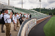 Master's in Athletic Administration students photograph Peden Stadium and the football field during a walking tour of campus on Friday, June 26, 2015. © Ohio University / Photo by Rob Hardin