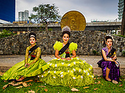 "08 APRIL 2017 - BANGKOK, THAILAND: Entertainers relax before the ""Amazing Songkran"" festival in Benchasiri Park in Bangkok. The festival was sponsored by the Tourism Authority of Thailand to highlight the cultural aspects of Songkran. Songkran is celebrated in Thailand as the traditional New Year's Day from 13 to 16 April. Songkran is in the hottest time of the year in Thailand, at the end of the dry season and provides an excuse for people to cool off in friendly water fights that take place throughout the country. Songkran has been a national holiday since 1940, when Thailand moved the first day of the year to January 1. Songkran 2017 is expected to be more subdued than Songkran usually is because Thais are still mourning the October 2016 death of revered King Bhumibol Adulyadej.       PHOTO BY JACK KURTZ"