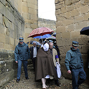 """A penitent (called """"Picao"""") prepares to whip himself during the procession of the fellowship of Santa Vera Cruz this Holy Friday in San Vicente de la Sonsierra (330km north of Madrid, in La Rioja), on April 10, 2009. This traditional procession takes its origin in the XVI century."""