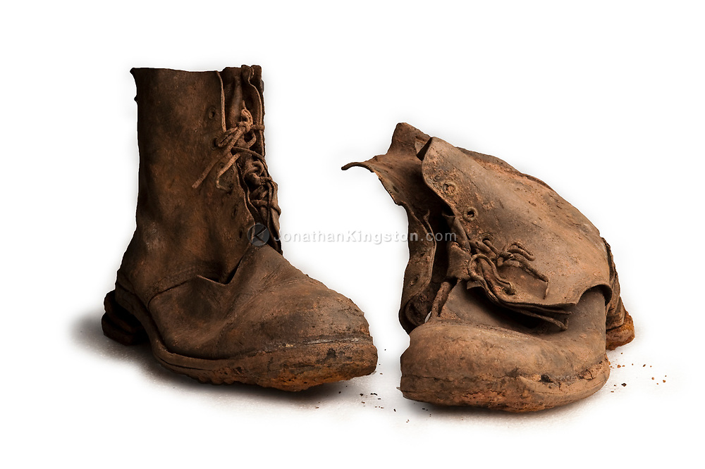 Soldiers mud caked boots, referred to as material evidence, recovered from a WWII battlefield awaiting forensic analysis in JPAC's Central Identification Laboratory on Oahu, Hawaii. Material evidence from an excavation site in the laboratory of the Joint POW/MIA Accounting Command, or JPAC, Hickam Air Force Base, Oahu, Hawaii.  Lab scientists use a variety of techniques to establish the identification of missing Americans, including analysis of skeletal and dental remains, sampling mitochondrial DNA, and analyzing material evidence, personal effects and life support equipment.  The command was activated on Oct. 1, 2003, created from the merger of the 30-year-old U.S. Army Central Identification Laboratory, Hawaii, and the 11-year-old Joint Task Force - Full Accounting.  The mission of JPAC is to achieve the fullest possible accounting of all Americans missing as a result of the nation's past conflicts.  On average, JPAC identifies about six MIAs each month.  To date, the U.S. government has identified over 1,400 individuals.