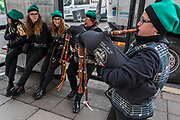 The Sons de La Cosetania pipe band warm up before the London St Patrick's Day parade from Piccadilly to Trafalgar Square.