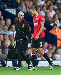 14.08.2011, The Hawthorns, West Bromwich, ENG, PL, West Bromwich Albion vs Manchester United, im Bild Manchester United's Rio Ferdinand goes off injured with a hamstring strain during the Premiership match against West Bromwich Albion at the Hawthorns, EXPA Pictures © 2011, PhotoCredit: EXPA/ Propaganda/ D. Rawcliffe *** ATTENTION *** UK OUT!