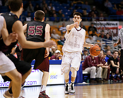 Wheeling Central guard Trenton Smith (11) tells his team mate to move down low he's making a move during a semi final round game at the Charleston Civic Center.