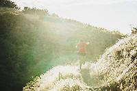 Summer days. Sasha Yakovleff dropping into the Wild Rose downhill, North Salt Lake, Utah.