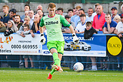 Leeds United goalkeeper Bailey Peacock Farrell (1) passes the ball during the Pre-Season Friendly match between Guiseley  and Leeds United at Nethermoor Park, Guiseley, United Kingdom on 11 July 2019.