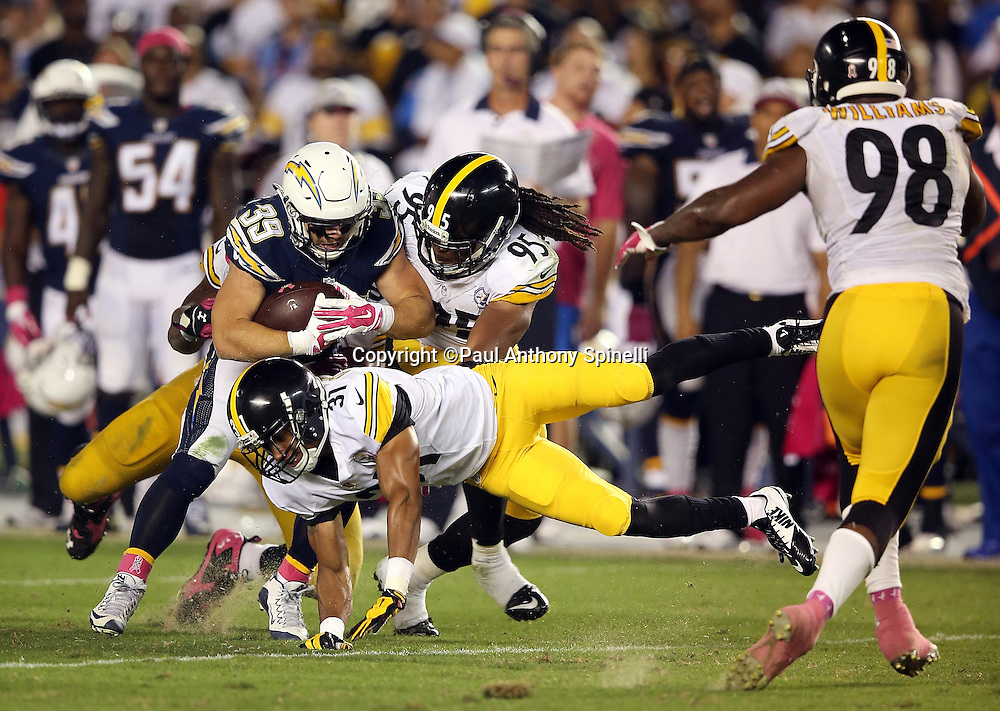 San Diego Chargers running back Danny Woodhead (39) gets tackled by diving Pittsburgh Steelers defensive back Ross Cockrell (31) and Pittsburgh Steelers outside linebacker Jarvis Jones (95) as he runs the ball during the 2015 NFL week 5 regular season football game against the Pittsburgh Steelers on Monday, Oct. 12, 2015 in San Diego. The Steelers won the game 24-20. (©Paul Anthony Spinelli)