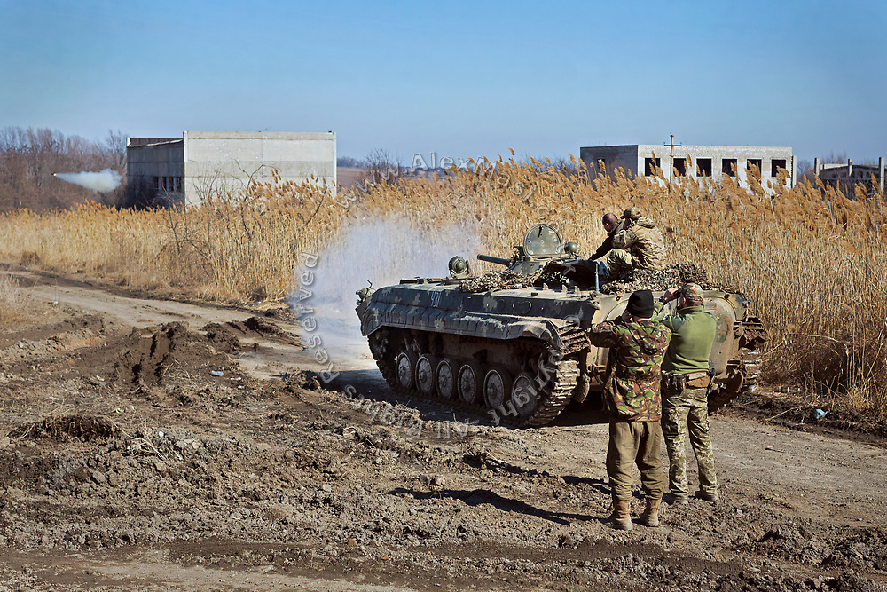 Soldiers are practising aim with a tank near their base in Myronivka, near the frontline in eastern Ukraine.