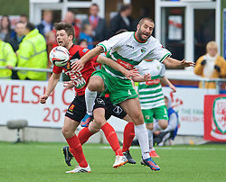 NEWTOWN, WALES - Saturday, May 2, 2015: The New Saints' Phil Baker battles with Newtown's Jason Oswell during the FAW Welsh Cup final match at Latham Park. (Pic by Ian Cook/Propaganda)