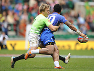 LONDON, ENGLAND - Sunday 11 May 2014, Mark Richards of South Africa tackles Fale So'oialo of Samoa during the Plate semi final match between South Africa and Samoa at the Marriott London Sevens rugby tournament being held at Twickenham Rugby Stadium in London as part of the HSBC Sevens World Series.<br /> Photo by Roger Sedres/ImageSA