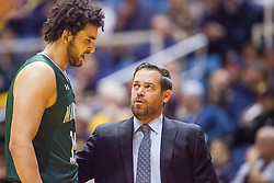 Nov 28, 2016; Morgantown, WV, USA; Manhattan Jaspers head coach Steve Masiello talks with Manhattan Jaspers center Ahmed Ismail (15) on the bench during the first half against the West Virginia Mountaineers at WVU Coliseum. Mandatory Credit: Ben Queen-USA TODAY Sports