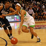 Skylar Diggins, Notre Dame, drives past Kaleena Mosqueda-Lewis, Connecticut, during the Connecticut V Notre Dame Final match won by Notre Dame during the Big East Conference, 2013 Women's Basketball Championships at the XL Center, Hartford, Connecticut, USA. 11th March. Photo Tim Clayton