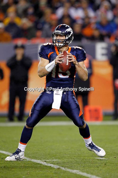 Denver Broncos quarterback Tim Tebow (15) throws a pass during the NFL week 11 football game against the New York Jets on Thursday, November 17, 2011 in Denver, Colorado. The Broncos won the game 17-13. ©Paul Anthony Spinelli