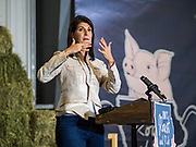"15 JUNE 2019 - BOONE, IOWA: Former UN Ambassador NIKKI HALEY speaks on behalf of US Senator Joni Ernst, (R-IA) during ""Joni's Roast and Ride,"" an annual motorcycle ride / barbecue fund raiser hosted by Ernst. Ernst, Iowa's junior US Senator, kicked off her re-election campaign during the ""Roast and Ride"", an annual fund raiser and campaign event has she held since originally being elected to the US Senate in 2014.  PHOTO BY JACK KURTZ"