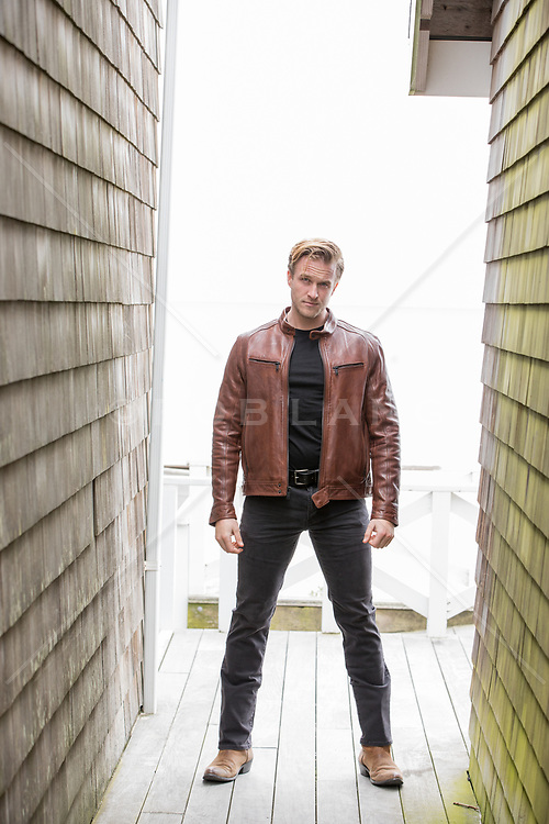 handsome man outdoors in a leather jacket