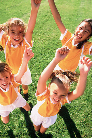 Girls Celebrating Soccer Victory --- Image by © Jim Cummins/CORBIS