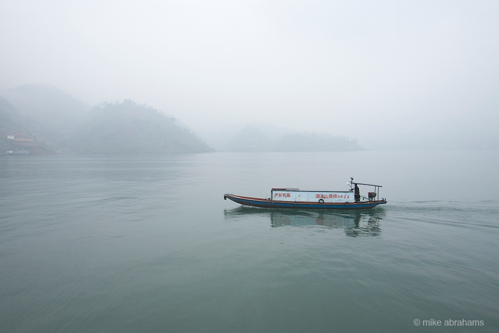 A small boat in the early morning fog.The Three Gorges, Yangtze river, The People's Republic of China