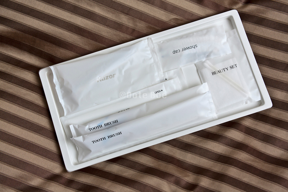 Toiletries on bed in a business hotel Japan