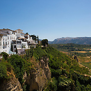 The white villages of Ronda, Spain, is a lovely town in the province of Malaga, within the community of Andalusia. This photograph is shot from the Puente Nuevo that spans the 120 meter deep chasm.<br />