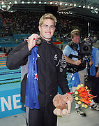 New Zealand's Moss Burmester celebrates after winning gold in the mens 200m butterfly final during the swimming at the Melbourne Sports & Aquatic Centre on day one of the XVIII Commonwealth Games, Melbourne, Australia, Thursday, March 16 2006. Photo: Michael Bradley/PHOTOSPORT<br /><br /><br /><br />149771
