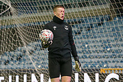 Everton goalkeeper Jordan Pickford (1) in warm up feels the pain and winces during the The FA Cup fourth round match between Millwall and Everton at The Den, London, England on 26 January 2019.