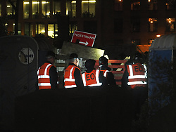© licensed to London News Pictures. London, UK. 14/07/12. Bailiffs attempt to dismantle barricades erected by activists ahead of the eviction. Enforcement officers clear the remaining 'Occupy' protest camp in London's Finsbury Square during the early hours of this morning after Islington Council won a High Court battle over the site. Photo credit: Jules Mattsson/LNP