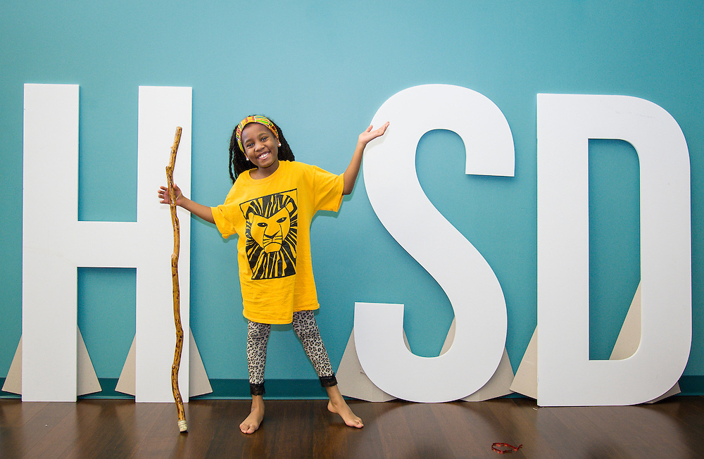 """Staff and students pose as the """"I"""" in HISD, July 31, 2014."""
