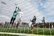 Harwood goalie Max Hill leaps to make a save as L:are Region's Brady Perron (10) leaps to head the ball during the DII boys soccer championship game between Harwood and Lake Region at South Burlington High School on Saturday afternoon November 4, 2017 in South Burlington. (BRIAN JENKINS/for the FREE PRESS)