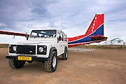 Landrover meets FIGAS light aircraft for resupply at Sea Lion Island in the Falkland Islands