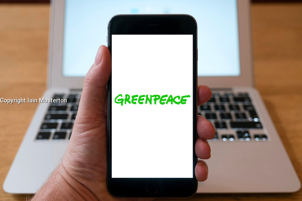 Greenpeace environmental pressure group home page on iPhone smart phone mobile phone