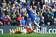 Arsenal's Hector Bellerin tackles Chelsea's Marcos Alonso during the Premier League match between Chelsea and Arsenal at Stamford Bridge, London, England on 17 September 2017. Photo by John Potts.