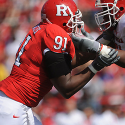 Apr 18, 2009; Piscataway, NJ, USA; Rutgers DL Justin Francis (91) battles OL Devon Watkis (71) during the second half of Rutgers' Scarlet and White spring football scrimmage.