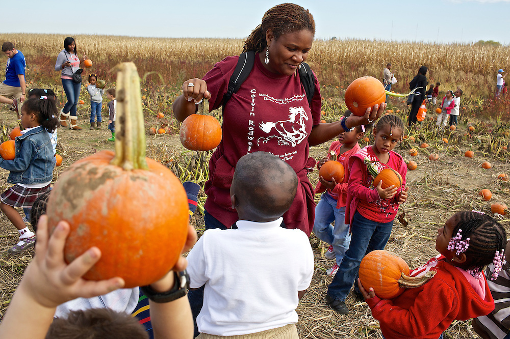 "Calvin Rodwell Elementary School Pre-kindergarten teacher Erika Parker, left, helps students select a pumpkin to take home at Summers Farm in Frederick, MD on Oct. 24, 2012. The visit to the farm was part of a ""Common Core"" reading and learning unit for their class, which aims to follow up non-fiction reading with learning in the field. The day prior the children read a book about going to a farm."