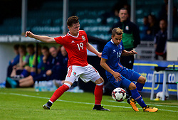 RHYL, WALES - Monday, September 4, 2017: Wales' Kieran Holsgrove and Iceland's Jónatan Ingi Jónsson during an Under-19 international friendly match between Wales and Iceland at Belle Vue. (Pic by Paul Greenwood/Propaganda)