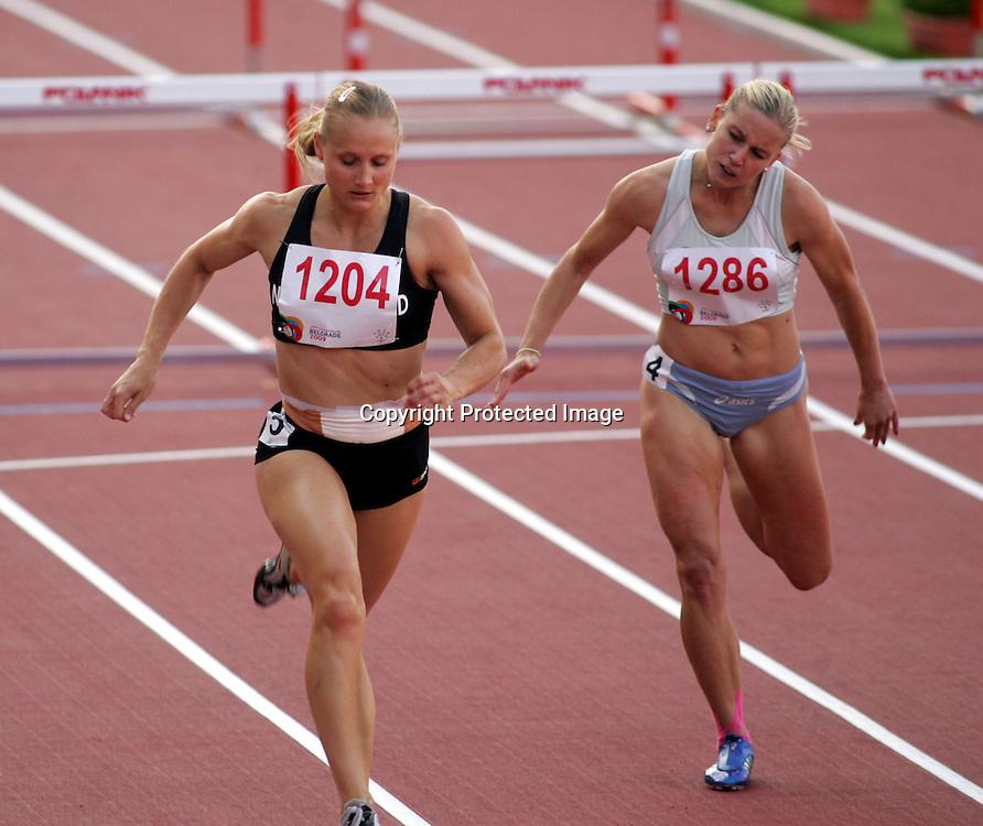 10.07.2009 Belgrade(Serbia)<br />Universiade athletics women's 100m Hurdles  final <br />Miller Andrea (L) New Zeland and Tomic Marina(R) Slovenia<br />Foto:Aleksandar Djorovic