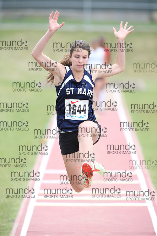 Holly Holltrop of St Mary CHS - Brockville competes in the midget girls long jump at the 2013 OFSAA Track and Field Championship in Oshawa Ontario, Thursday,  June 6, 2013.<br /> Mundo Sport Images / Sean Burges