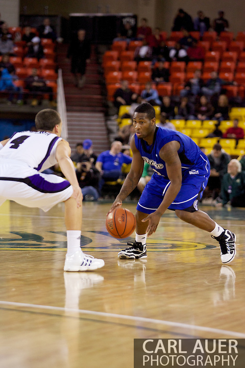November 27th, 2010:  Anchorage, Alaska - Drake Bulldog Kurt Alexander (3) looks for a play in the Bulldog's 81-82 loss to Weber State in the third place game of the Great Alaska Shootout.