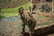 A military commander at a post near the front lines talks on the phone on Sunday, May 8, 2016 in Talish, Nagorno-Karabakh. Due to intense nearby fighting in early April, the entire village has been evacuated of civilians.