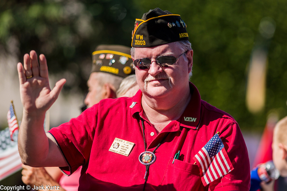 "11 NOVEMBER 2013 - PHOENIX, AZ: STEVEN STYBLO, marches in the Phoenix Veterans Day Parade. The Phoenix Veterans Day Parade is one of the largest in the United States. Thousands of people line the 3.5 mile parade route and more than 85 units participate in the parade. The theme of this year's parade is ""saluting America's veterans.""    PHOTO BY JACK KURTZ"
