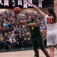 1st year guard Kyanna Giles (9) of the Regina Cougars in action during the home game on January  28 at Centre for Kinesiology, Health and Sport. Credit: Arthur Ward/Arthur Images
