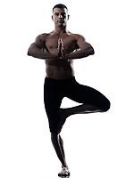 Man yoga balance Vriksha-asana the Tree Pose posture balance isolated studio on white background
