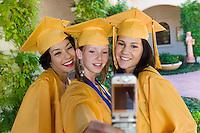 Graduates Using Cell Phone Camera