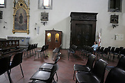 person waiting for confession Italy
