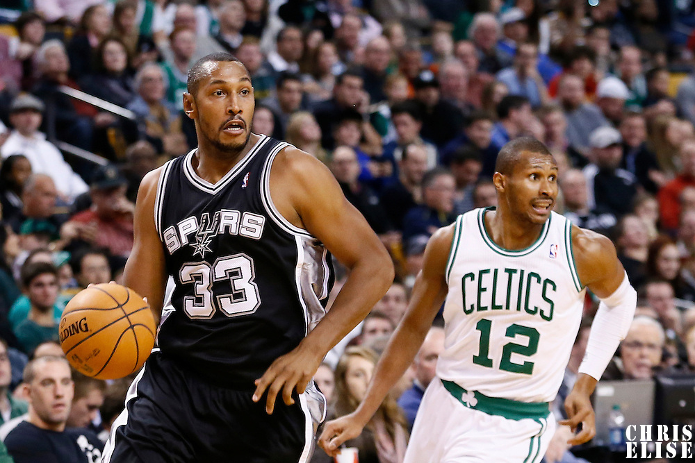 21 November 2012: San Antonio Spurs center Boris Diaw (33) drives past Boston Celtics shooting guard Leandro Barbosa (12) during the San Antonio Spurs 112-100 victory over the Boston Celtics at the TD Garden, Boston, Massachusetts, USA.