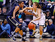 SOUTH BEND, IN - MARCH 04: As Kaleena Mosqueda-Lewis #23 of the Connecticut Huskies guards Michaela Mabrey #23 of the Notre Dame Fighting Irish dribbles the ball at Purcel Pavilion on March 4, 2013 in South Bend, Indiana. Notre Dame defeated Connecticut 96-87 in triple overtime to win the Big East regular season title. (Photo by Michael Hickey/Getty Images) *** Local Caption *** Kaleena Mosqueda-Lewis; Michaela Mabrey
