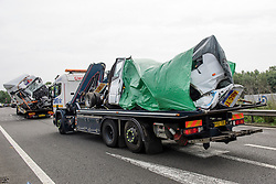 © Licensed to London News Pictures. 26/08/2017. Milton Keynes, UK. Remains of the minibus (pictured right) and a lorry (pictured left) involved in the crash, are removed from the M1 motorway near Milton Keynes. Police say that several people are dead and four others have been taken to hospital after the accident on the southbound carriageway in the early hours of this morning. Photo credit: Ben Cawthra/LNP