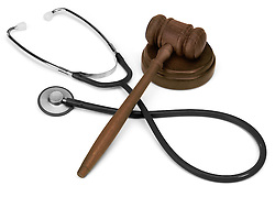 gavel and stethescope on white background