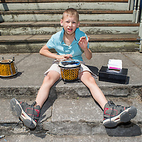 Caden Steele, 8, plays his bongos for tips on N. Mississippi Ave. in Portland. 12:05pm